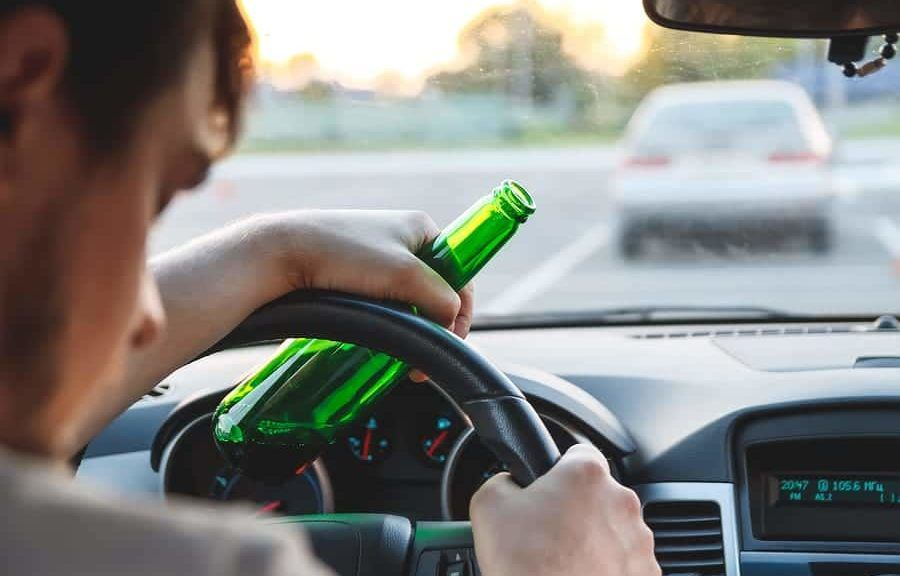 man-driving-drunk-with-beer
